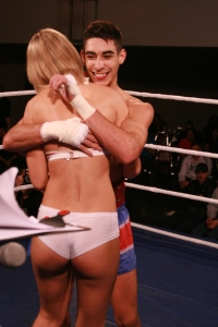Josh Jauncey steals a squeeze from a Ring Girl